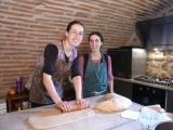 Two of the sisters making bread